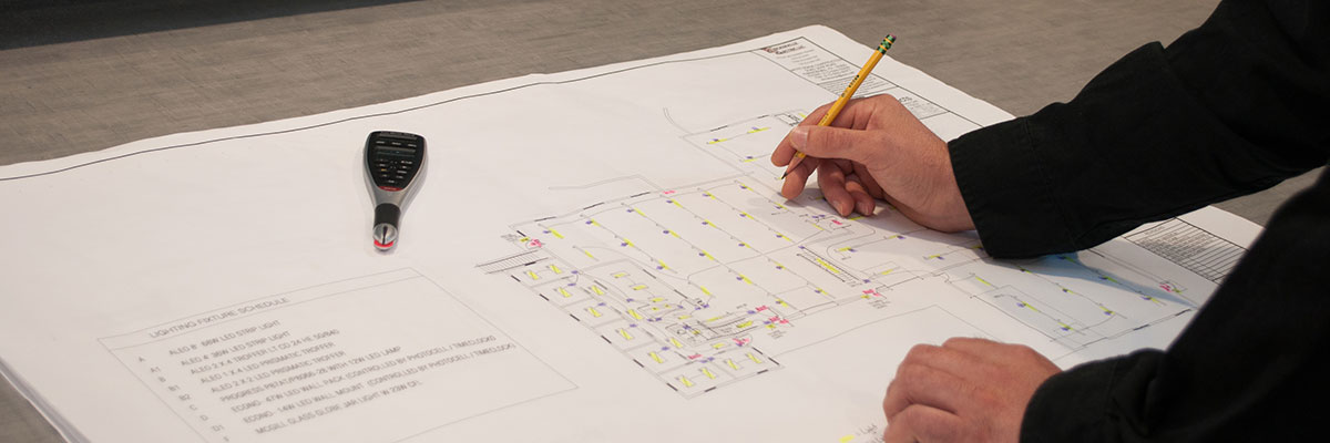 Man Drawing on Building Plans